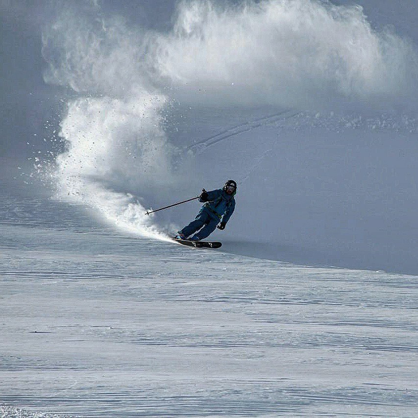 Skier embracing the lush powder in Siberia