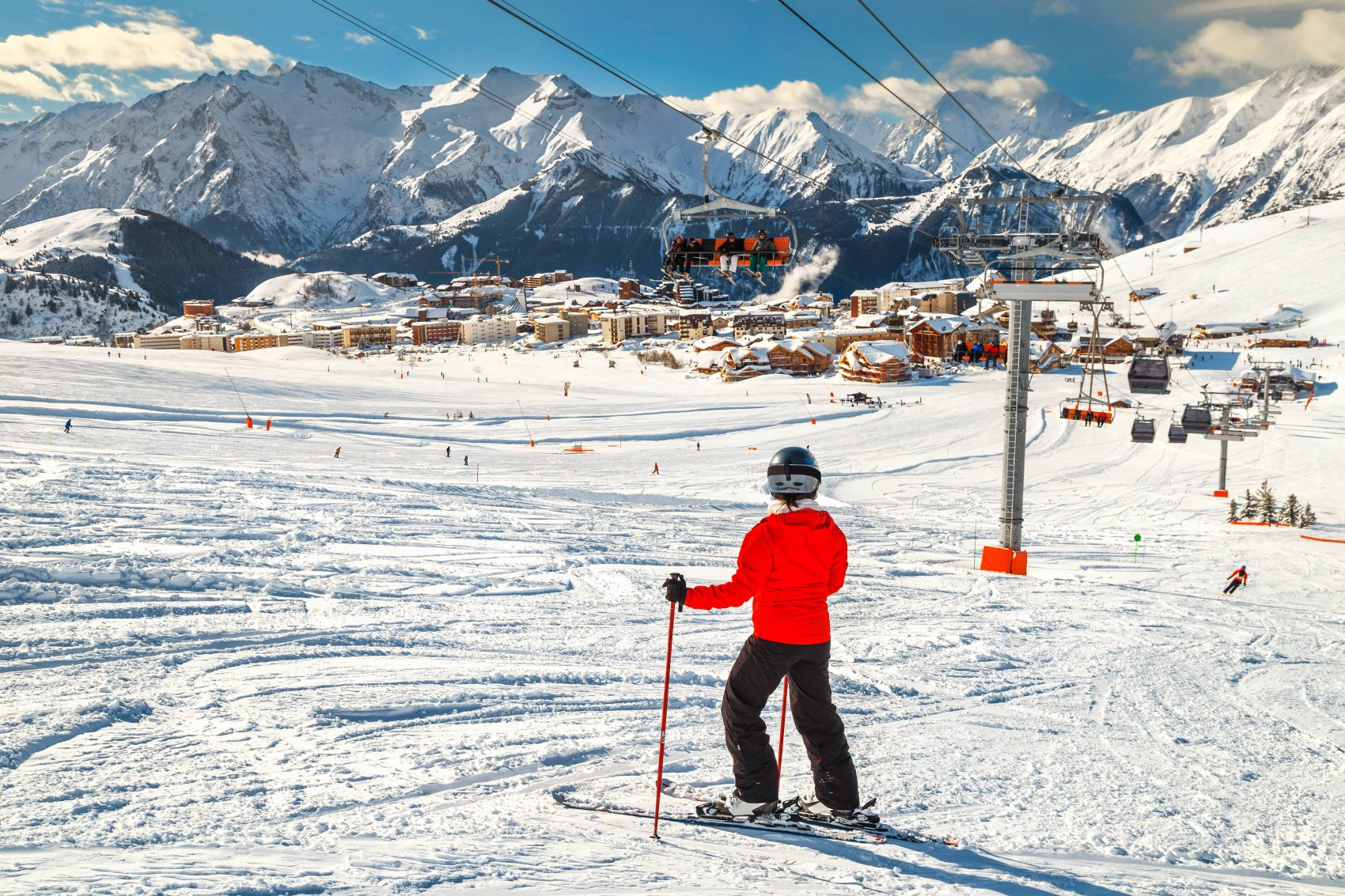 Wonderful famous ski resort with skiers in high mountains, Alpe d Huez, France